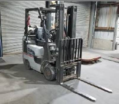 Nissan MCP1F1A18LV cushion/solid tire 3500lb warehouse style propane fuel forklift.