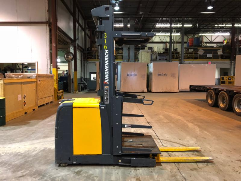 Jungheinrich EKS208 electric stand up rider 220lb capacity narrow aisle wire guided order pickers.
