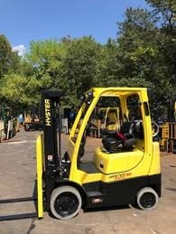 Hyster S50FT 5000lb propane fuel cushion solid tire 4 wheel sit down rider warehouse forklift.