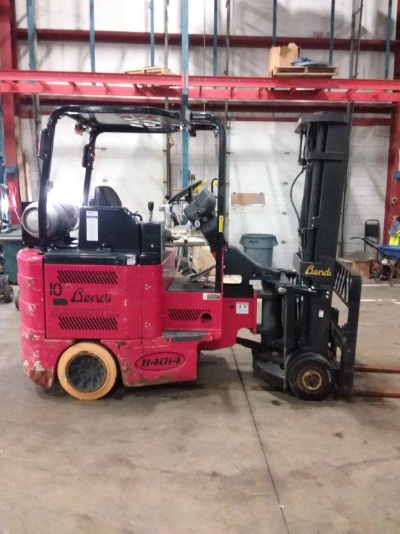 Bendi B40 sit down rider 4000lb very narrow aisle articulating side loading warehouse forklift on LP gas.