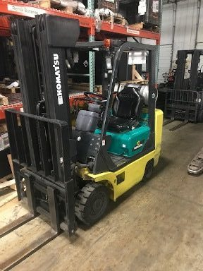 Komatsu FG18ST17 3500lb propane fuel cushion solid tire warehouse forklift with rental specs.