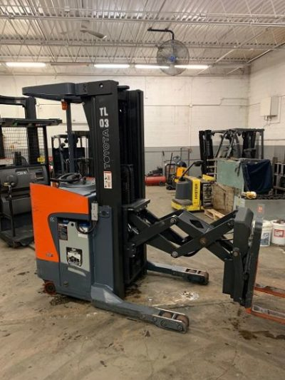 Toyota 8BDRU15 narrow aisle electric stand up rider 3,000lb double reach warehouse forklift.