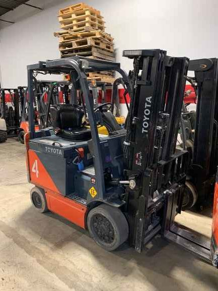 Toyota 8FBCU25 electric 4 wheel sit down rider 5000lb EE rated solid cushion tire warehouse forklifts