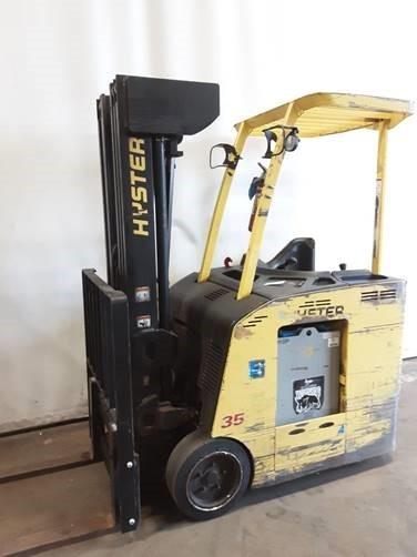 Hyster E35HSD electric narrow aisle stand up rider 3500lb end control counterbalanced lift truck.