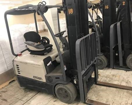 Crown SC5245-35 electric 3 wheel 3500lb sit down rider narrow aisle warehouse forklift.