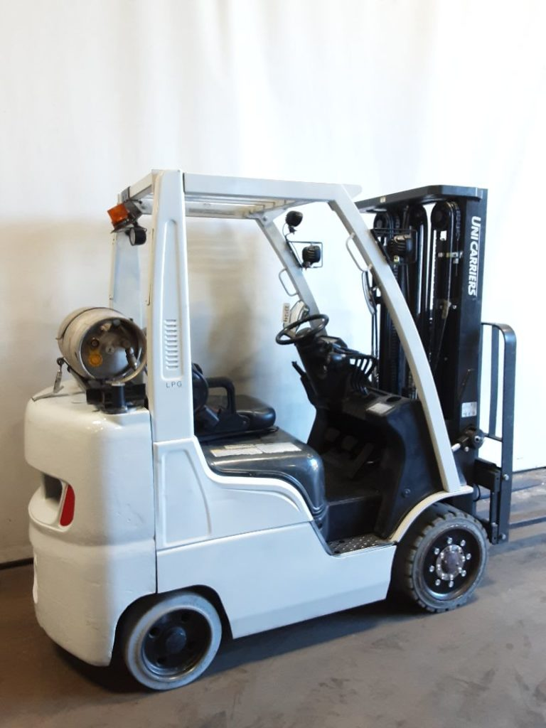 Nissan Unicarriers MCP25 5000lb propane fuel solid cushion tire warehouse forklift.