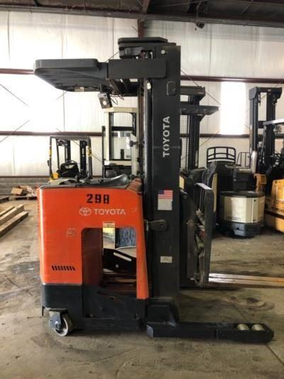 Toyota 9BDRU15 electric narrow aisle stand up rider 3000lb double reach warehouse forklift.